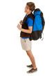 smiling male tourist with backpack, full length