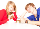 teenage couple with  unlocked tinned food