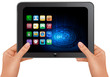 Hands holding digital tablet computer with icons