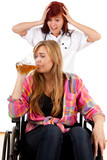 female doctor with drinking beer patient on wheelchair