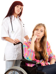 woman doctor is pushing her patient on a wheelchair