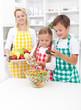 Kids preparing a healthy fresh salad