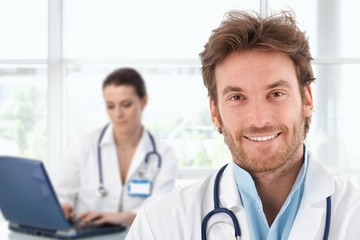 Portrait of young doctor at clinic