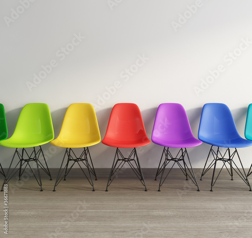 Interior with vintage plastic colored chairs on wood for Colored salon chairs