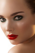 Woman with dark green smoky-eyes make-up, red lips