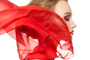 Model with waving red silk scarf. Vamp style, lady in red