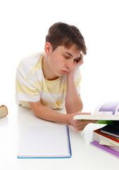 Boy reading studying textbooks