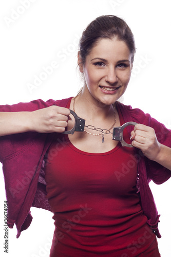 Pretty young woman with handcuffs