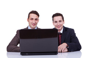 Two business men at a desk