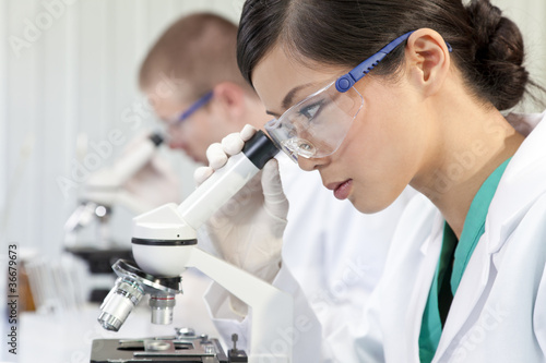 Chinese Female Woman Scientist & Microscope In Laboratory