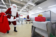 santa claus waiting for present in factory