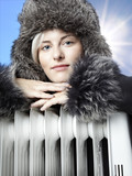 Beautiful winter lady with pelt cap rest on radiator outdoors poster