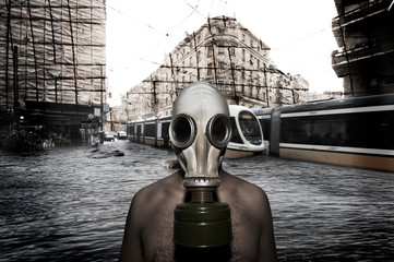 Man with gas mask in a landscape catastrophic