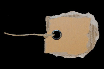 cardboard blank tag isolated on black background