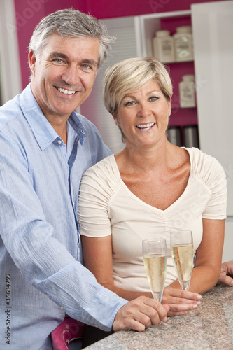 Man & Woman Couple Drinking Champagne In Kitchen