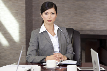 Beautiful Asian Chinese Businesswoman At Boardroom Table