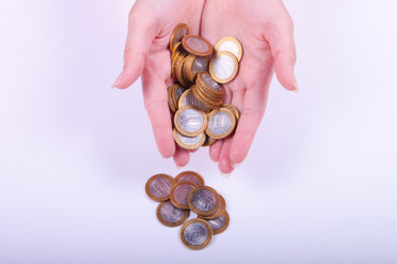 coins in the hands of