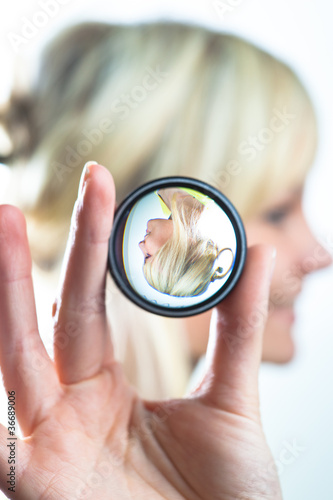 woman showing the principle of imaging through a lens