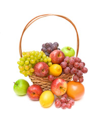 set fruit in a wicker basket on a white background