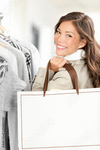 Shopper woman showing shopping bag