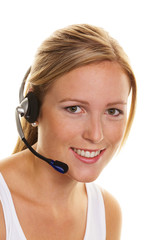 Frau mit Headset im Kundenservice