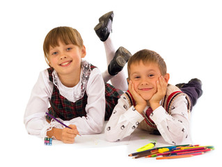 two kids drawing on the floor
