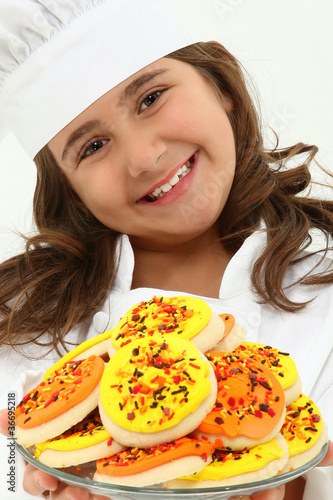 Adorable Girl Child in Chef Uniform with Iced Thanks Giving Day