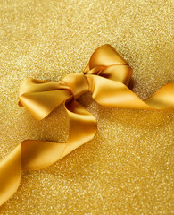 Greeting Card. Gold Bow on a Blinking Background