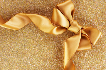 Holiday Background. Gold Bow on a Blinking Background