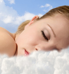 Portrait of a young girl sleeping  with  clouds