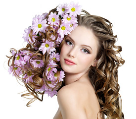 Fashion beautiful young woman with flower in hairs