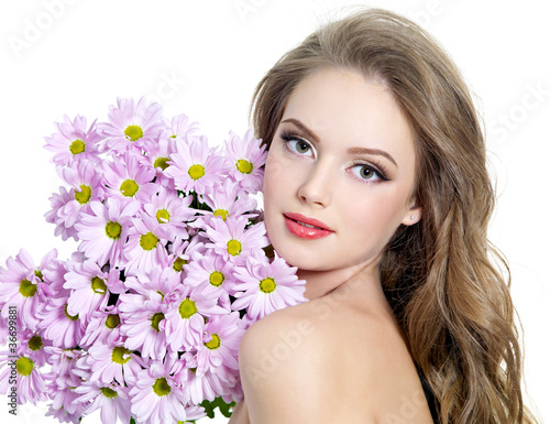 Pretty young adult girl  with flower