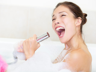 woman singing in bath shower