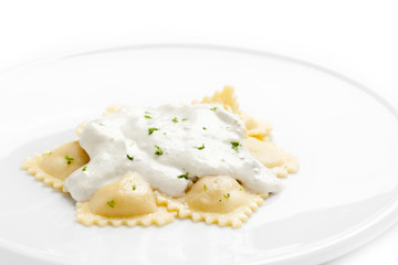 Ravioli with cheese sauce