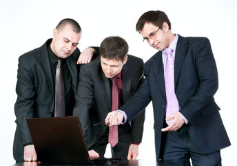 Three businessmen talking on the computer