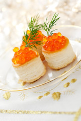 Vol-au-vents filled with red caviar and dill for holiday