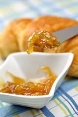 Orange jam and croissant