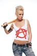 Punk girl with a bat isolated on white.