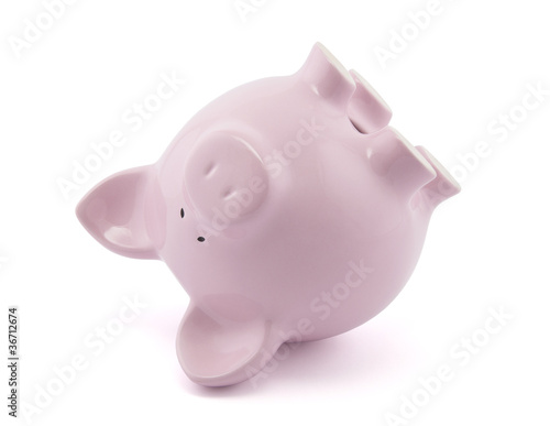 Pink piggy bank upside down. Clipping path included. Poster