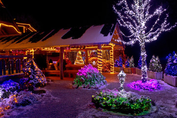 Christmas fantasy - lodge and tree lights