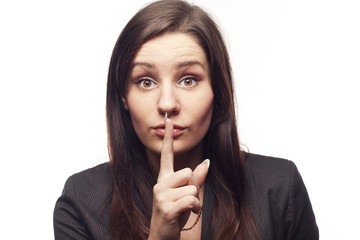 Young businesswoman saying shh
