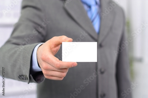 Man holding visiting card