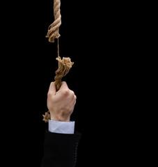 Hand hanged on damaged rope