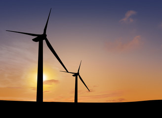 silhouette of wind turbine generating electricity on sunset