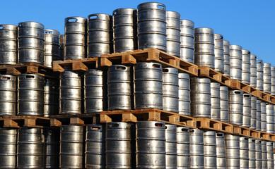 stock of steel kegs of beer in factory yard