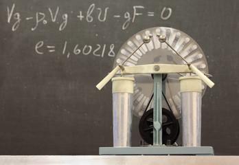 Wimshurst influence Machin, formula written on blackboard