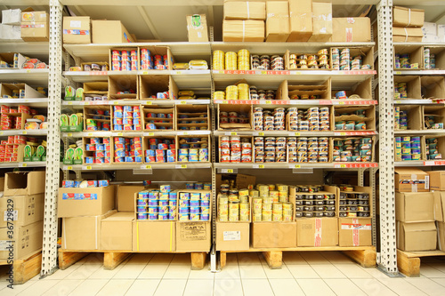 Shelves with canned fish in shop - 36729829