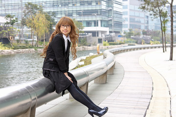 asia business woman sitting outdoor