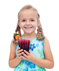 Happy healthy little girl with fresh juice