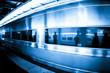 Commuters in Rushing Train Window Reflections